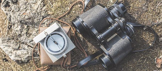binoculars-and-compass